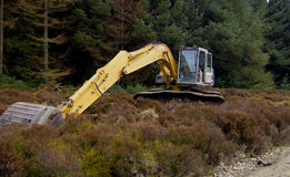 Earth Mover 3. Earth moving machinery laying idle in the forest Stock Photo