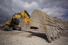 Earth mover bucket and gravel royalty free stock image