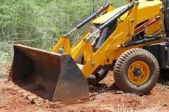 Earth mover clearing forest