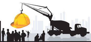 Earth mover lifting a hardhat Royalty Free Stock Images