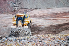 Earth mover loading rocks in a quarry Stock Photo