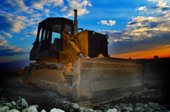 Earth mover machine at sunrise Stock Photo