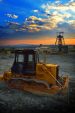 Earth mover machine at sunrise Stock Photos