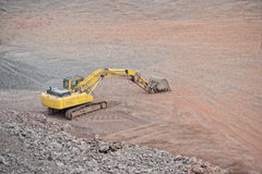 Earth mover in a Porphyry rock quarry Stock Photo