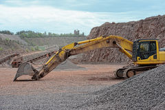 Earth mover in a Porphyry rock quarry Stock Photography