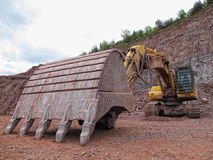 Earth mover in a Porphyry rock quarry Royalty Free Stock Photo