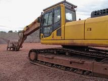 Earth mover in a Porphyry rock quarry Stock Image