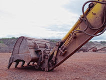 Earth mover in a Porphyry rock quarry Royalty Free Stock Photography