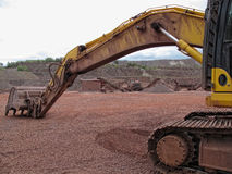 Earth mover in a Porphyry rock quarry Royalty Free Stock Images