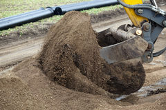 Earth mover with sand Stock Image
