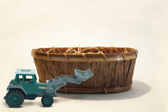 Earth mover with wooden basket Royalty Free Stock Photos