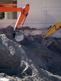 Earth movers. A pair of earth movers digging a foundation for a high rise Stock Photography