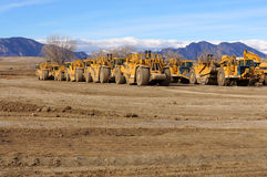 Earth Movers grading surfaces Stock Images