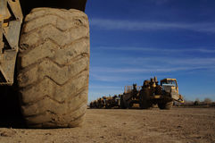 Earth Movers grading surfaces Stock Photos