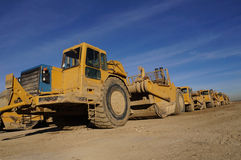 Earth Movers grading surfaces Royalty Free Stock Photos