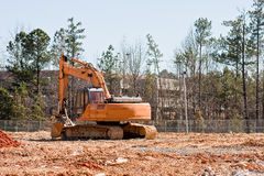 Earth Moving Equipment in Dirt Field Stock Photos