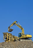 Earth moving excavator in action Stock Images