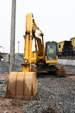 Earth-moving machinery - Backhoe. Excavator is no movement, ladle ekskavatra rests on the ground Royalty Free Stock Images