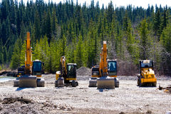 Earth moving machines line-up Stock Image