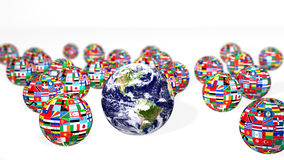 Earth and national flags on white Royalty Free Stock Photos