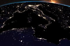 Earth night light at central Europe. Italy close up view. Sunshine from space. Elements of this image furnished by NASA stock illustration