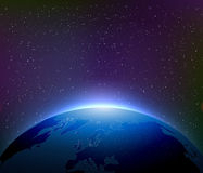 Earth at Night Among Starry Sky Royalty Free Stock Images