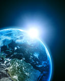 Earth in open space Stock Images
