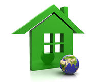 The Earth our house. The planet Earth and green home Stock Photo