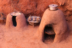 Earth ovens and tea kettles Stock Photography