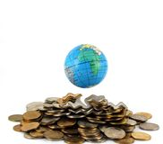 Earth over money Royalty Free Stock Photos