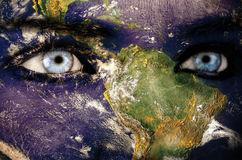 Earth overlay on a face Royalty Free Stock Image