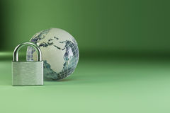 Earth with padlock on green background Royalty Free Stock Images