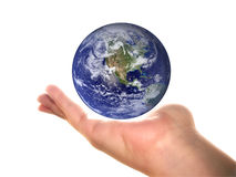 Earth on a palm. Earth on an open woman's palm, over white Royalty Free Stock Photography