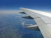 Earth and plane wing view from an illuminator Royalty Free Stock Photos