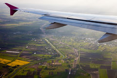 Earth and plane wings. View of earth from an airplane royalty free stock photos