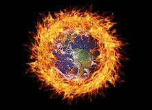 Earth Planet burning surronded by flames. Climate change or environment pollution concept.  royalty free stock image