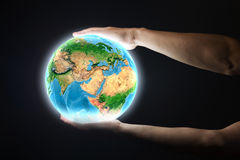 Earth planet. Close up of human hand holding Earth planet. Elements of this image are furnished by NASA stock photography