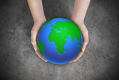 Earth planet in female hands Stock Photography