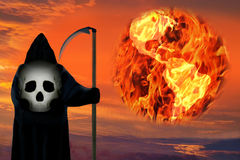 Death figure. Earth planet in fire. Global catastrophe.. The death figure wearing black hood with scull and looking on the Earth. The planet is in fire and in Stock Photo