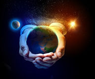 Earth planet in hands stock photography