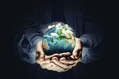 Earth planet in hands stock photos