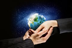 Earth planet in hands Stock Image
