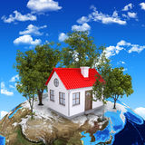Earth planet image with house on surface Stock Images
