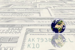 Earth planet on a money Royalty Free Stock Image