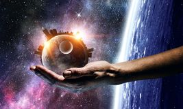 Whole world in hands. Mixed media. Earth planet in palm. Elements of this image are furnished by NASA Stock Photography