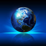 Earth planet on a reflective surface Royalty Free Stock Image