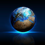 Earth planet on a reflective surface Stock Images