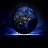 Earth planet on a reflective surface Royalty Free Stock Photography