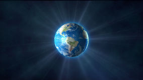 Earth. Planet Earth shines rays on the background of the stars of the sky stock video footage