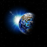 Earth planet in sun rays Royalty Free Stock Photography